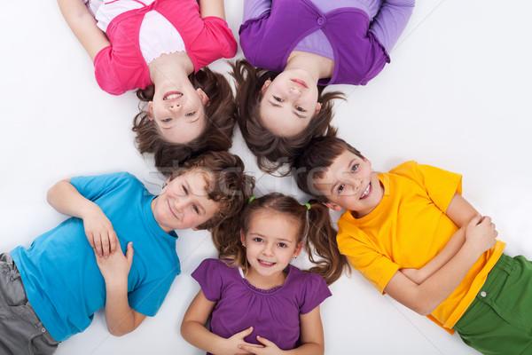 Cinquième heureux enfants étage cercle Photo stock © ilona75