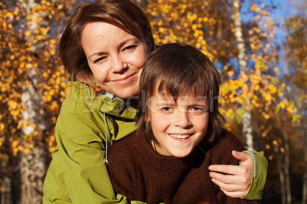 Woman and her son on an autumn stroll Stock photo © ilona75