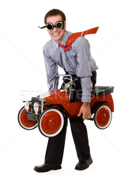 Crazy businessman with budget transportation Stock photo © ilona75