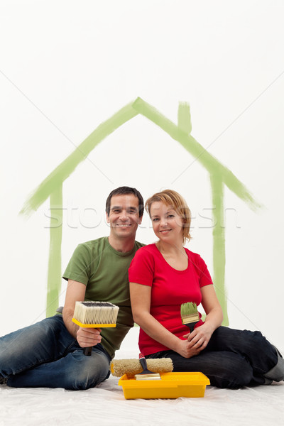Couple in their new home painting Stock photo © ilona75