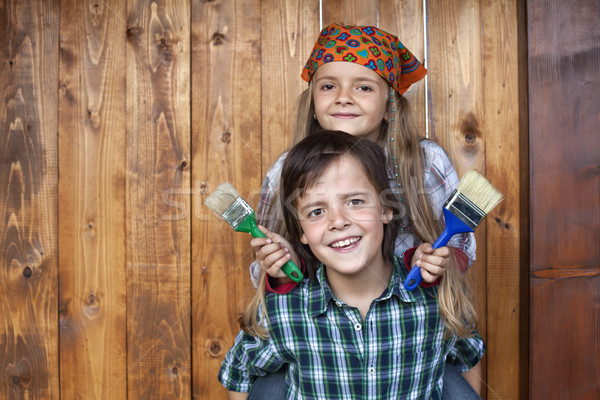 Happy kids repainting the wood shed Stock photo © ilona75