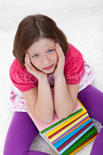 Young girl with headache from too much learning Stock photo © ilona75