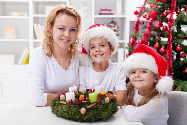 Christmas time - family with advent wreath Stock photo © ilona75