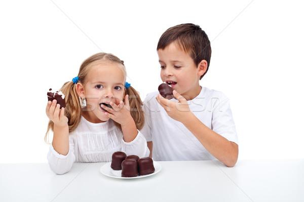 Mutlu çocuklar yeme krem şanti çikolata tatlı Stok fotoğraf © ilona75