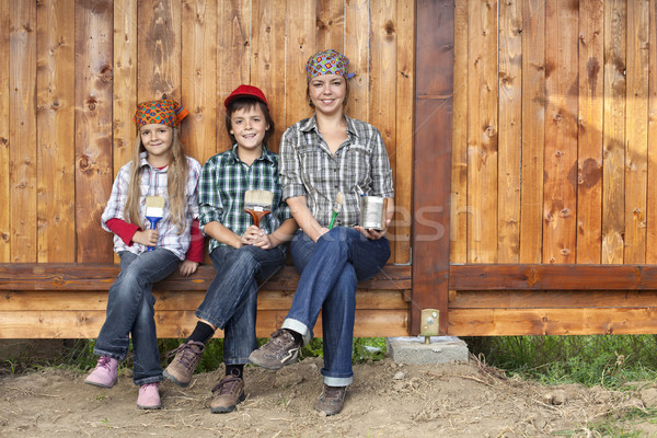 Stock photo: Painting the wood shed