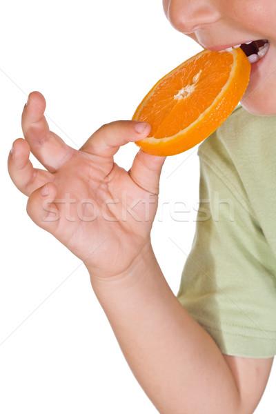 Dziecko jedzenie pomarańczowy plasterka strony owoców Zdjęcia stock © ilona75
