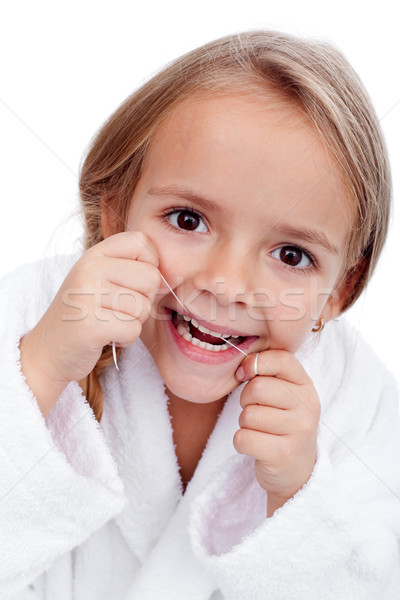 Little girl flossing Stock photo © ilona75
