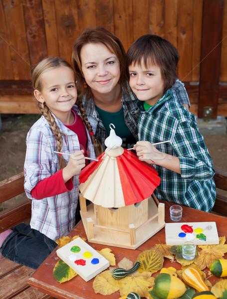 Woman and kids preparing a bird house in autumn Stock photo © ilona75