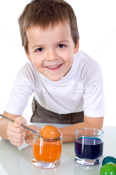 Happy boy dyeing the easter eggs Stock photo © ilona75