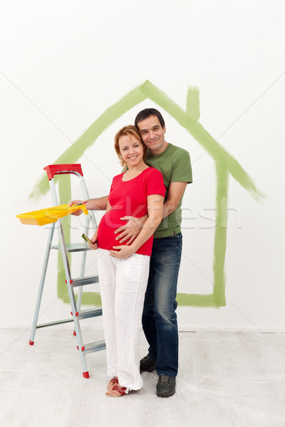 Couple expecting a baby redecorate their new home Stock photo © ilona75