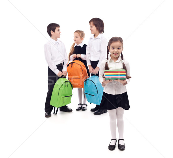 Kids returning to school with books and backpacks Stock photo © ilona75