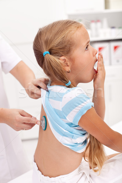 Coughing little girl at the doctor Stock photo © ilona75