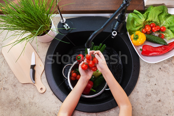 Child hands washing vegetables at the kitchen sink Stock photo © ilona75
