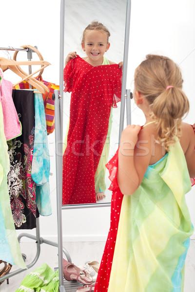 Trying on dresses is fun Stock photo © ilona75