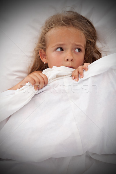 Little girl in bed awaken by nightmares Stock photo © ilona75