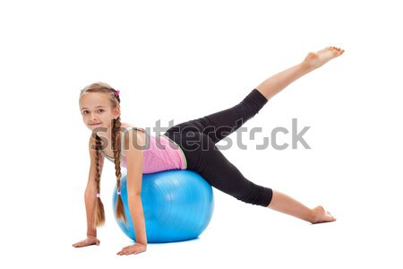 Young girl exercising - using a large gymnastic rubber ball Stock photo © ilona75