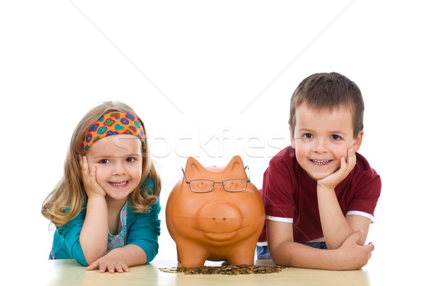 Kids with their expert piggy bank Stock photo © ilona75