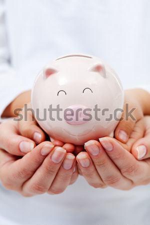 Cute small piggy bank in child hands Stock photo © ilona75