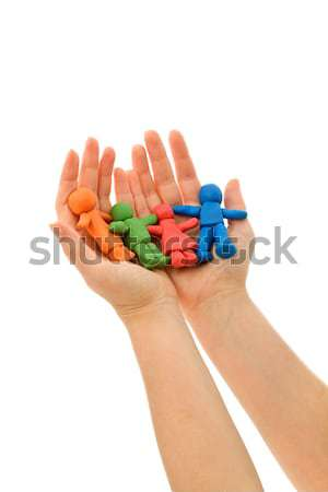 Hands folding colorful clay people Stock photo © ilona75