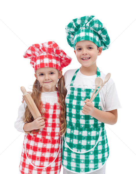 Happy kid chefs with wooden cooking utensils Stock photo © ilona75