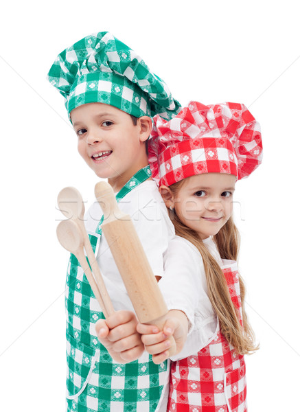 Happy chef kids with wooden cooking utensils Stock photo © ilona75