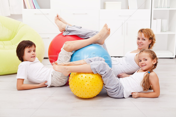 Happy healthy family with large gymnastic balls Stock photo © ilona75