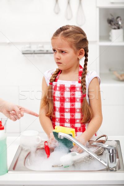 Sulking little girl doing the dishes Stock photo © ilona75