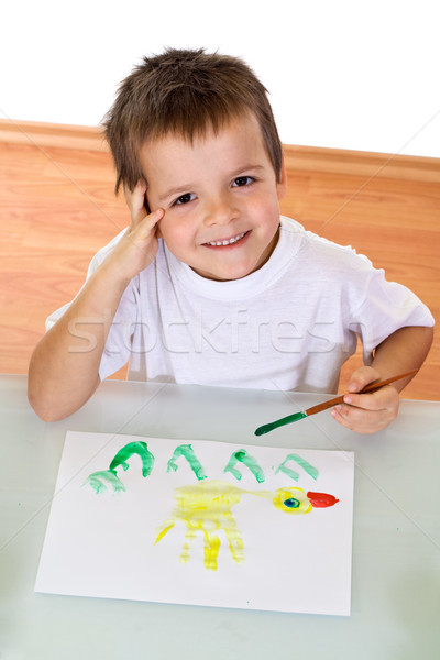 Boy painting with watercolors Stock photo © ilona75