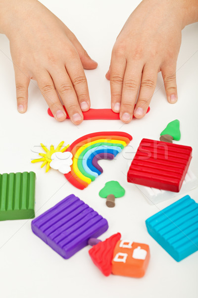 Child hands playing with modeling clay Stock photo © ilona75
