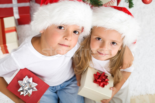 Christmas kids with santa hats and presents Stock photo © ilona75