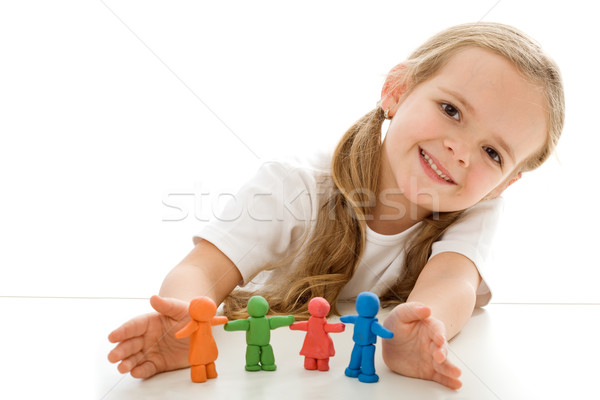 Little girl with colored clay figurines Stock photo © ilona75