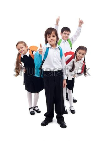 Happy elementary school kids - isolated Stock photo © ilona75
