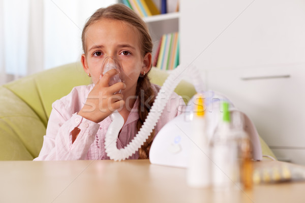 Young girl using inhaler device - relieve asthma and allergies s Stock photo © ilona75