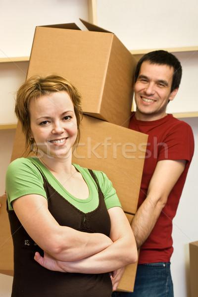 Happy couple moving - carrying boxes Stock photo © ilona75