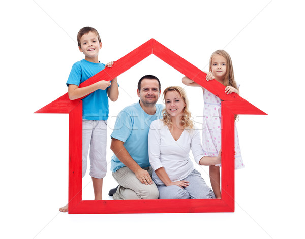 Young family with two kids holding house sign Stock photo © ilona75