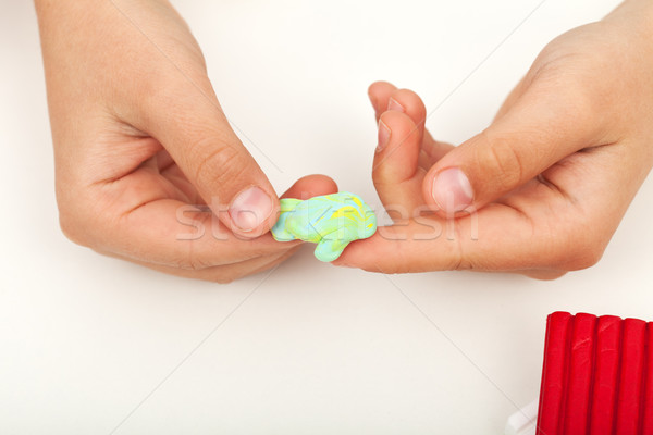 Child hands mixing clay of two colors Stock photo © ilona75