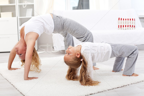 Healthy people doing gymnastic exercises at home Stock photo © ilona75