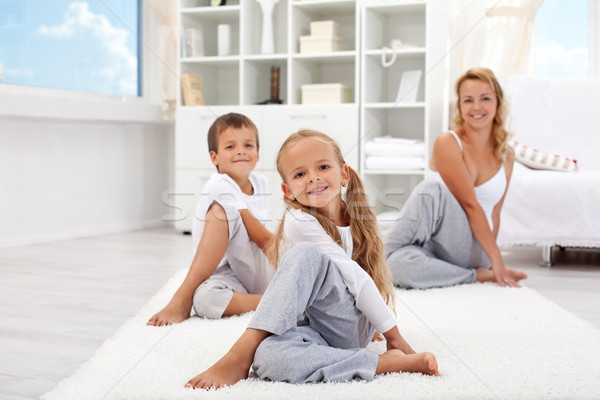 Kids and woman doing stretching exercises Stock photo © ilona75