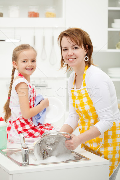 Happy girl and mother washing dishes Stock photo © ilona75