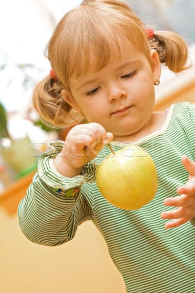Fille jouer pomme cute vert fruits Photo stock © ilona75