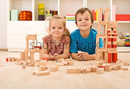 Gyerekek játszanak íj nyíl lövöldözés fakockák torony Stock fotó © ilona75