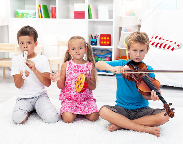 Kids playing on musical instruments Stock photo © ilona75