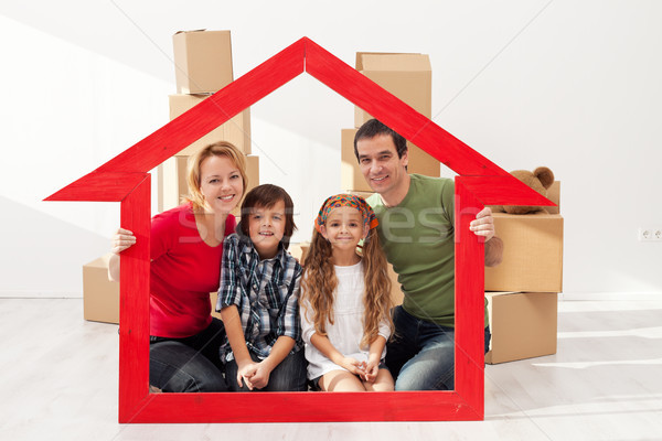 Family with kids in their new home Stock photo © ilona75