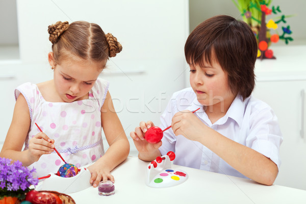 Boy and girl painting easter eggs Stock photo © ilona75