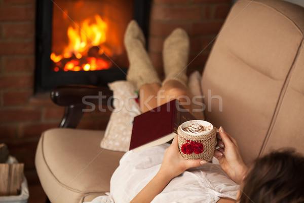 женщину расслабляющая огня Кубок горячий шоколад Сток-фото © ilona75