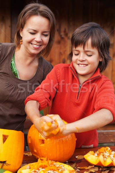 Boy having fun carving a jack-o-lantern for Halloween Stock photo © ilona75