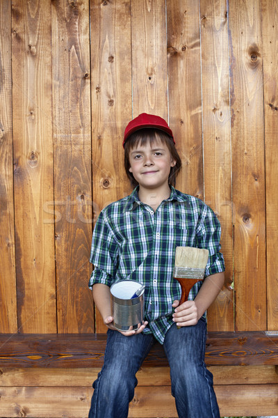 Boy painting the tool shed Stock photo © ilona75