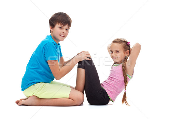 Kids doing gymnastic exercises - helping each other Stock photo © ilona75