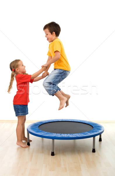 Kids having fun on a trampoline Stock photo © ilona75