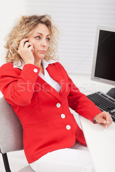 Business woman disappointed by her telephone conversation Stock photo © ilona75
